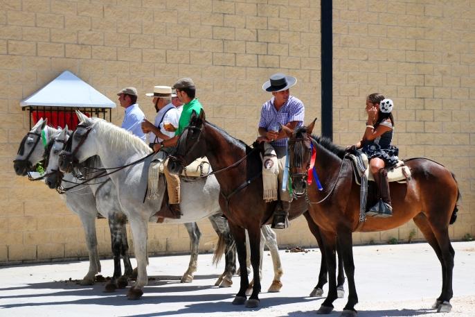 A group of horsemen outside the pabellon